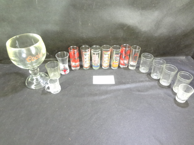 Coors Big 'O' glass and fifteen shot glasses