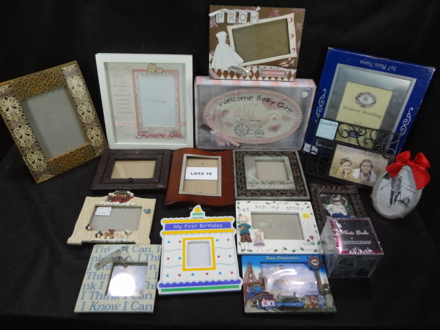 Huge lot of sixteen photo frames, various themes and sizes, and a Welcome Baby Girl plaque, all one money