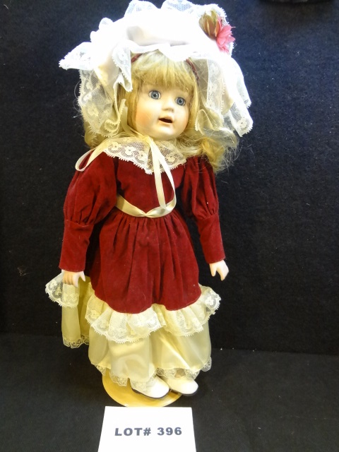 Adorable porcelain 'Red Velvet' doll, 15