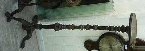An early 20thC Georgian style mahogany torchere,