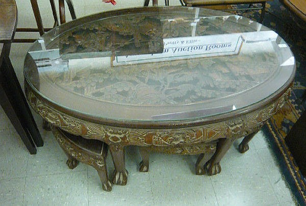 A modern Oriental hardwood coffee table, the oval