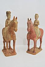 An interesting pair of China polychrome terracotta sculptures