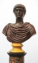 A red marble bust of a Roman Emperor