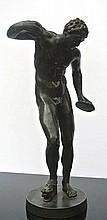 A bronze sculpture of a Satyr
