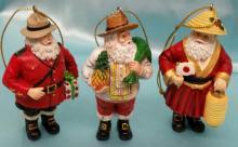 (3) vintage  Danbury Mint Santa Around The World Christmas Ornaments.
