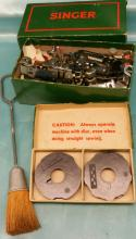 Large grouping of Singer Sewing Attachments, also some Singer Sewing Machine Needles and more