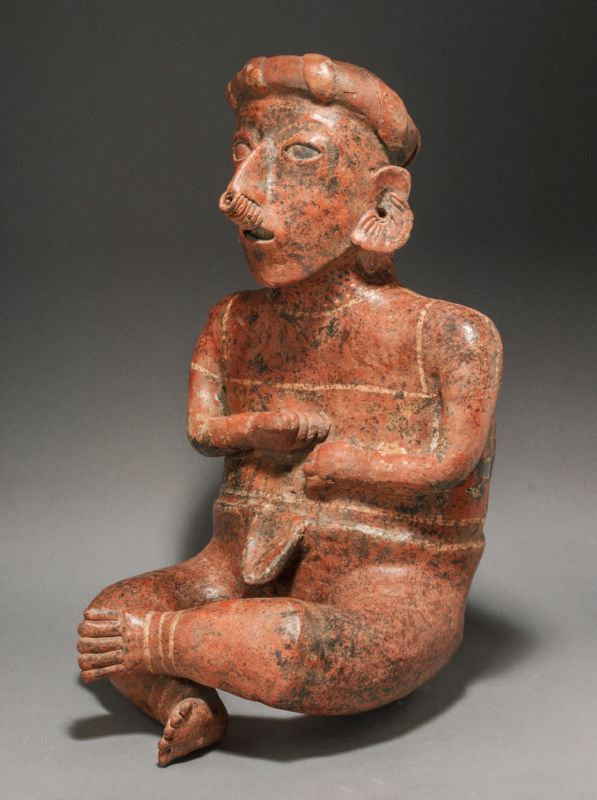 A LARGE NAYARIT SEATED MALE FIGURE, IXTLAN DEL RIO TYPE