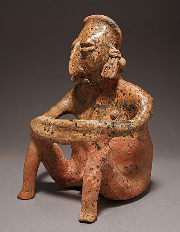 A JALISCO POLYCHROME SEATED MALE FIGURE, SAN JUANITO TYPE