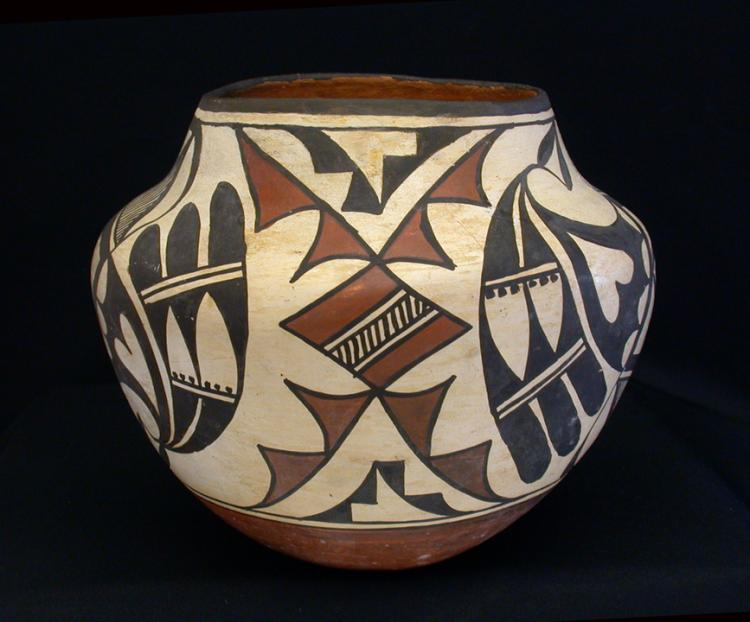 AN AMERICAN INDIAN LAGUNA/ ACOMA PUEBLO POLYCHROME JAR WITH UNIQUE DESIGNS