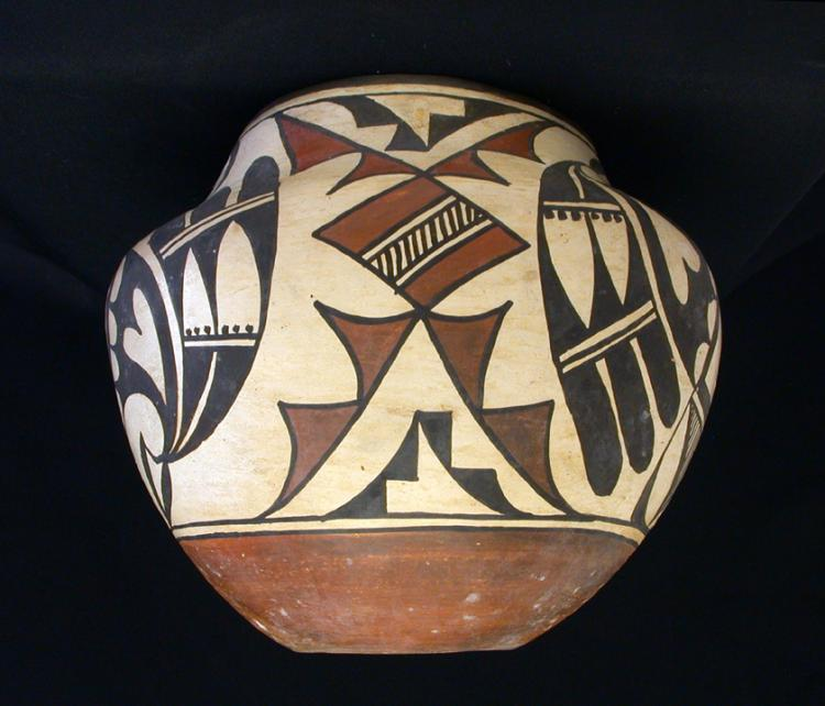 AN AMERICAN INDIAN LAGUNA/ ACOMA PUEBLO POLYCHROME JAR WITH UNIQUE DESIGNS