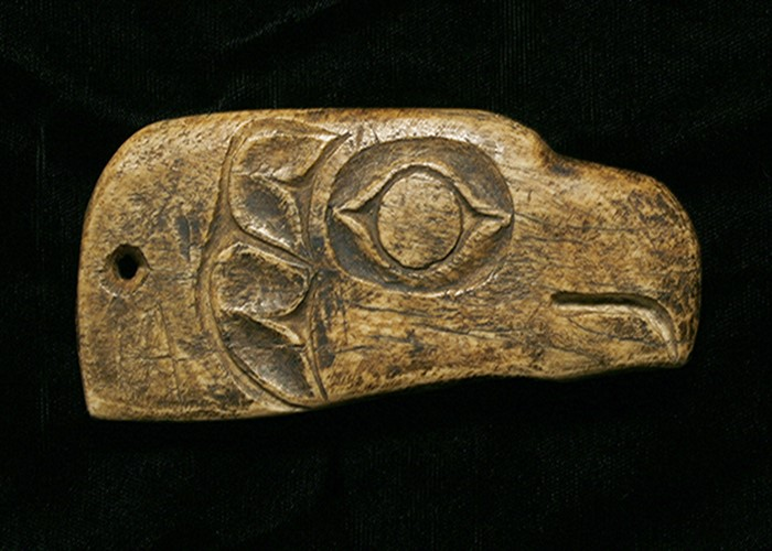 A SUPERBLY CARVED AMERICAN INDIAN NORTHWEST COAST BONE SHAMAN'S AMULET DEPICTING AN EAGLE'S HEAD.