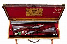 A pair of Holland & Holland Side-by-Side Shotguns, in their Case