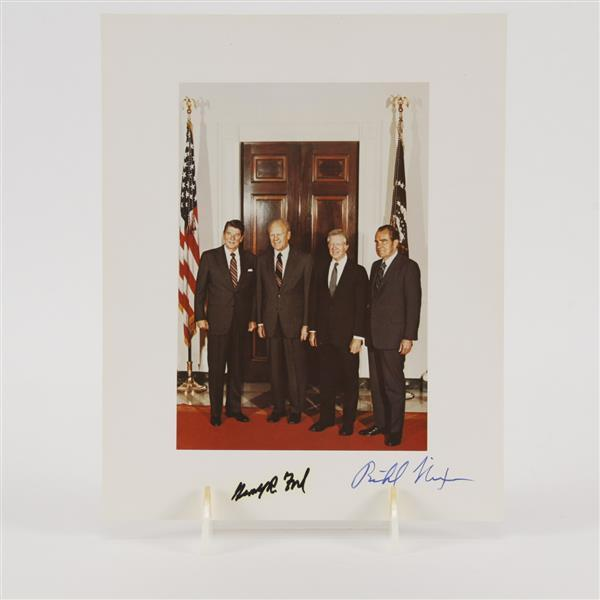 Photograph of 4 presidents; Reagan, Ford, Carter, and Nixon. Signed by Ford & Nixon.
