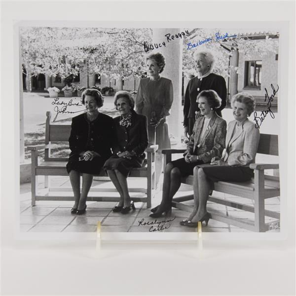 Signed b/w photo of former first ladies. Signed by Lady Bird Johnson, Betty Ford, Rosalynn Carter, Nancy Reagan, & Barbara Bush.