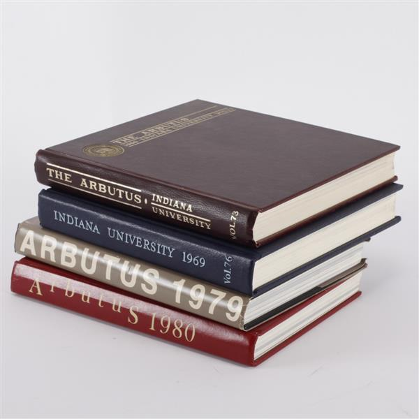Four Indiana University Arbutus yearbooks.