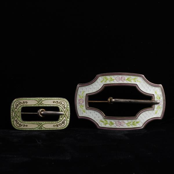 Two French enameled sterling silver belt buckles.