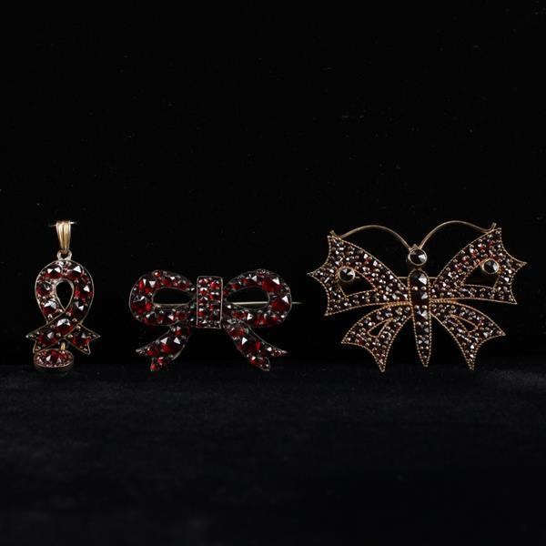 Victorian garnet jewelry 3pc.; butterfly & bow pin, and ribbon drop.