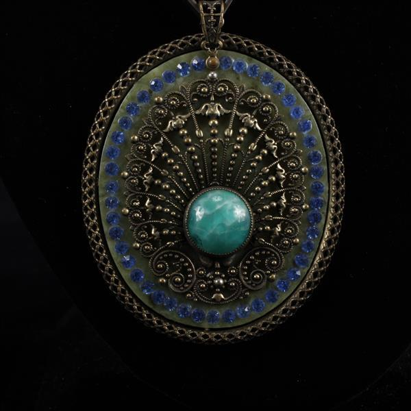 Art Deco jeweled and brass mounted celulloid pendant on silver chain necklace with green onyx polished stone cabochon.