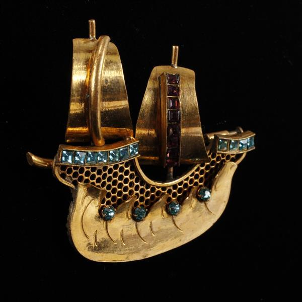 Art Deco Made in France Jeweled and Gilt sailing Viking ship brooch.