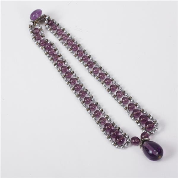 Attributed to Louis Rousselet amethyst glass in silver beaded channel with teardrop pendant; Made in France on clasp topped with jew...