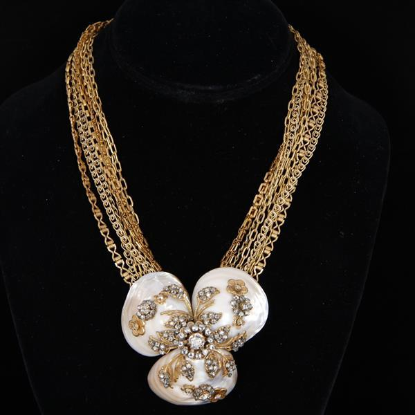 Miriam Haskell multi chain shell necklace with brass and clear rhinestone floral overlay.