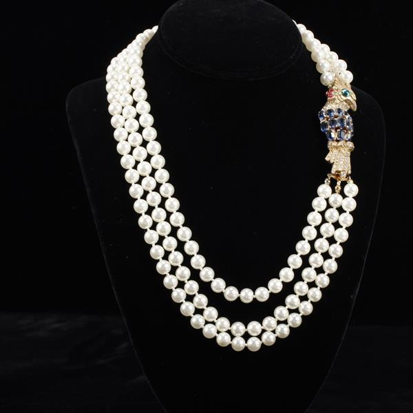 DeNicola multi strand faux pearl necklace with figural jeweled gold tone parrot clasp.