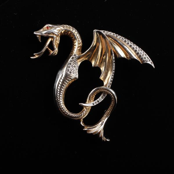 Unmarked gold tone and pave flying winged serpent / dragon pin brooch with ruby red glass eye.