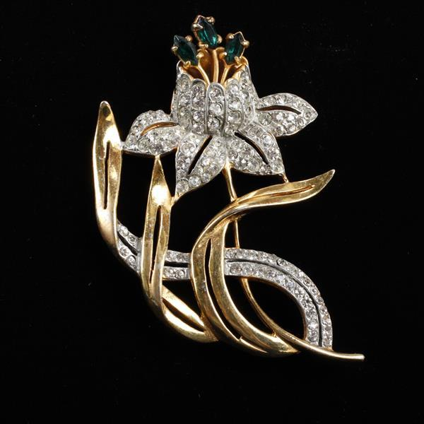 Reinad pave gold tone flower brooch with emerald crystal jewels.