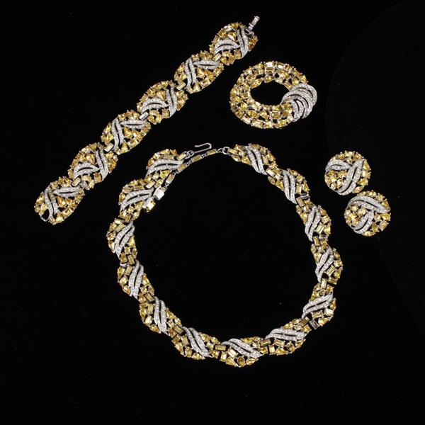 Trifari 4pc. pave & yellow rhinestone set. Necklace, braclete, brooch pin, & clip earrings.