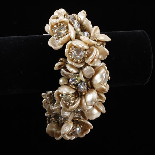 Extravagant Miriam Haskell Statement Floral Cluster Bracelet; profuse beading of champagne pearl finish petals and rhinestones.