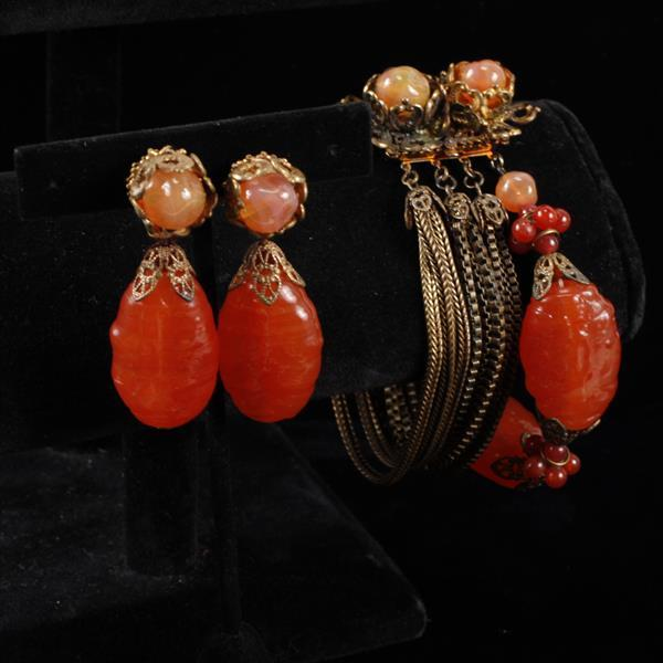 Miriam Haskell 2pc. Set; multi strand brass bracelet & clip earrings with large red orange poured glass beads.