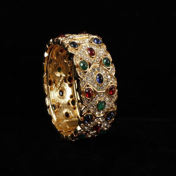 Ciner gold tone and pave hinged bangle bracelet with jewel tone jelly cabochons.