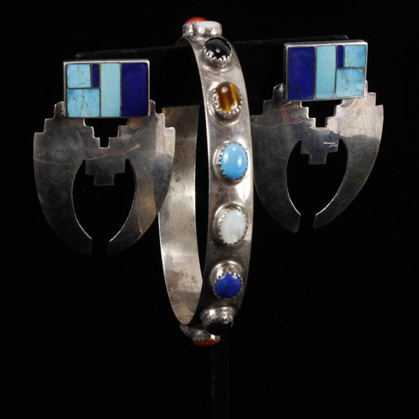 Native American Sterling Silver 2pc. Jewelry; jeweled bangle bracelet and turquoise, lapis inlay earrings, both signed.