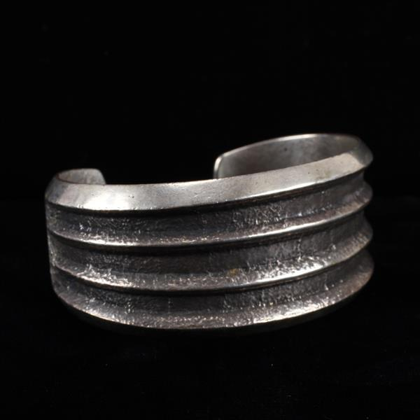 Charles Loloma (Hopi; 1921-1992) Tufa Cast Sterling Silver Cuff Bracelet, signed.