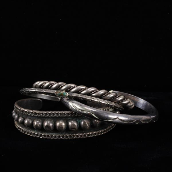 Four Native American sterling silver cuff bracelets