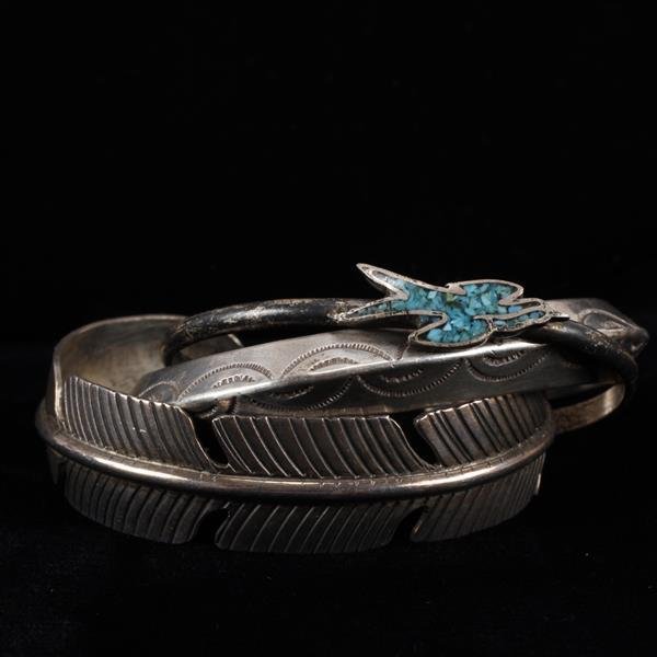Three Native American Sterling Silver cuff bracelets including a feather form signed Douglas Etsitty.