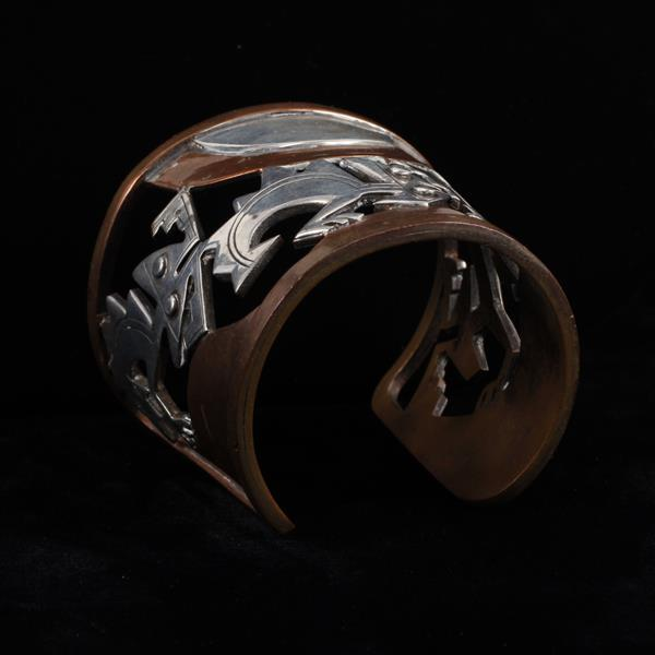 Graziella Laffi Peru Sterling Silver & Copper Mixed Metal Modernist cuff bracelet with folkloric stylized openwork figures.