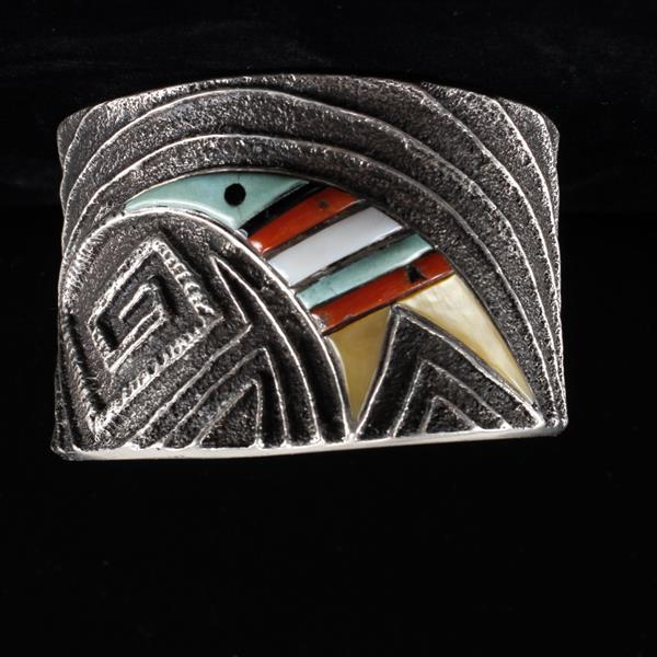 Native American Sterling Silver sandcast cuff bracelet with turquoise, coral, and MOP tribal stylized bird motif, signed.