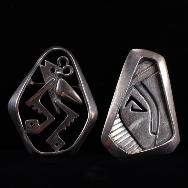 TWO Salvador Teran Sterling Silver Mexican Modernist pin brooches with stylized figure and pierced abstract design.