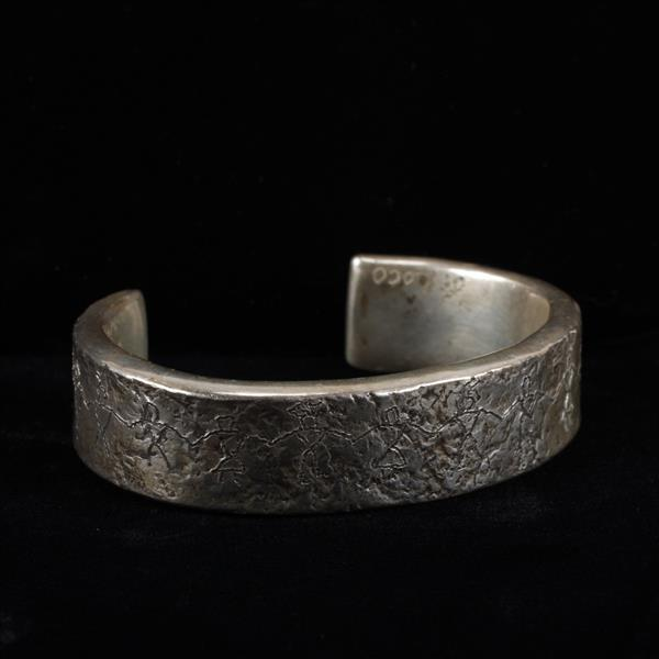 Jan Loco Native American Hand Hammered Heavy Sterling Silver Cuff Bracelet with inscribed figures.