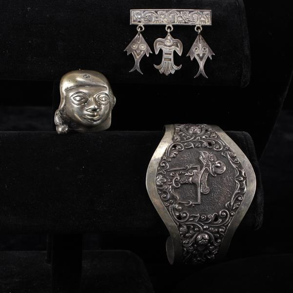Lot of 3 Peruvian silver pieces; Repousse Cuff bracelet, Face / Mask Pin, & Tribal bar pin with drop charms.