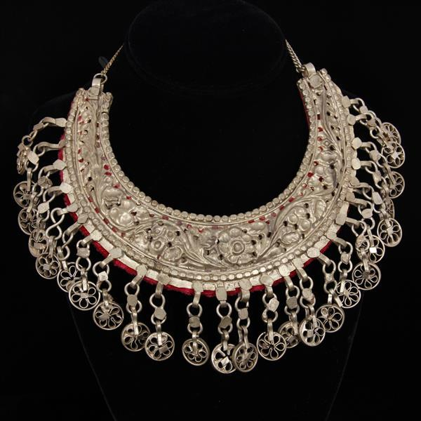 Turkoman / Turkmen Banjara Tribal Pierced Repousse Crescent Bib Necklace with filigree dangle medallions.