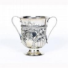 George III double handle repousse cup, London 1771.