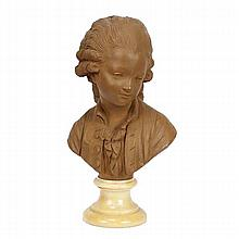 Continental terracotta clay bust of a young boy on alabaster base after a French model; 19th Century.