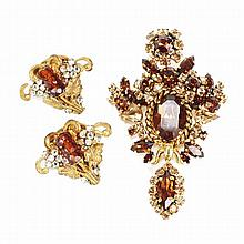 Vintage costume jewelry set: Christian Dior amber rhinestone dangle brooch with co-ordinating Miriam Haskell earring clips.