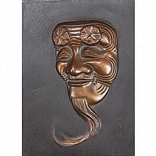 Japanese bronze relief plaque; Kabuki character theater mask.