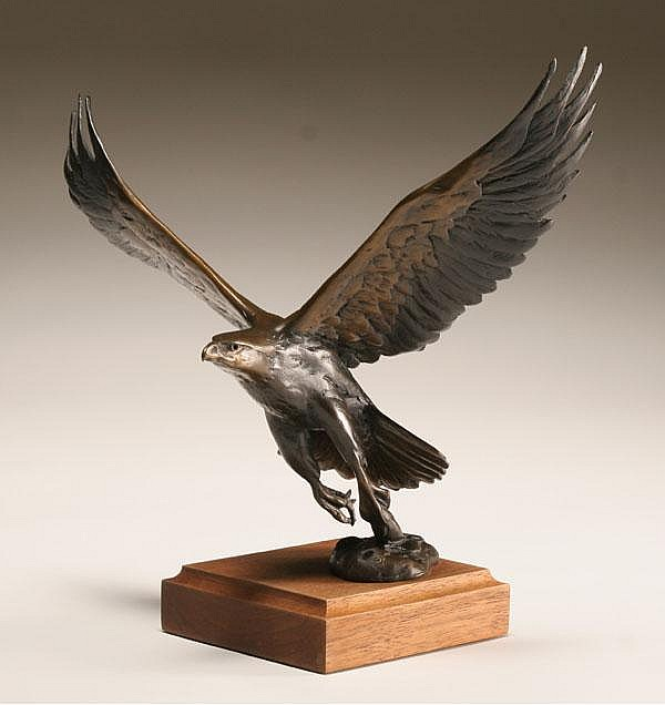 Chester Comstock (American, 20th century) an eagle in flight bronze sculpture