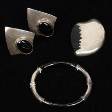 Vintage Mexican sterling silver 3pc. with onyx inlay; modernist Taxco brooch / pin, hinged bangle bracelet, and clip earrings.