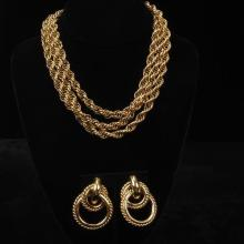 Givenchy vintage designer runway gold tone three strand chunky chain necklace with bar clasp and interlocking circular earrings.