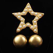 Givenchy vintage designer runway matte gold tone star and faux pearl pin / brooch and clip earrings.
